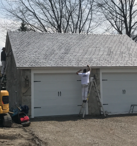 painters working on a garage
